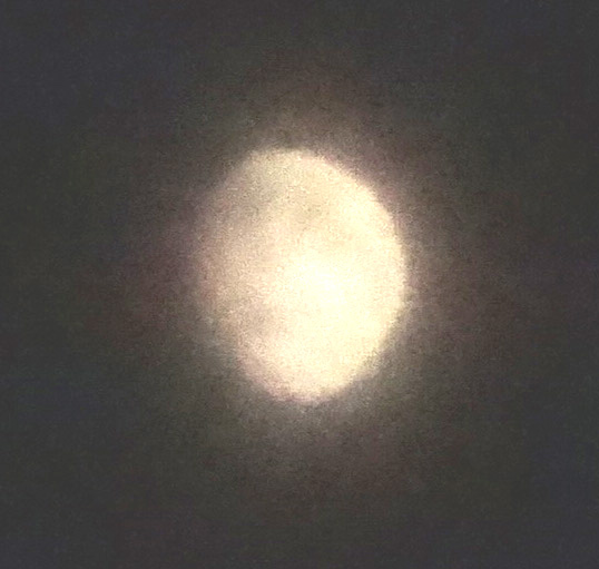 Moon shrouded in cloud